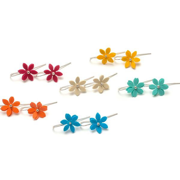 Daisy punch earrings Photo Andrew Barcahm