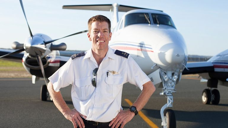 Steve Wallace on the Brisbane runway beside his plane.