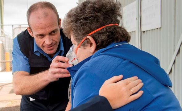 Picture of RFDS employee helping elderly lady