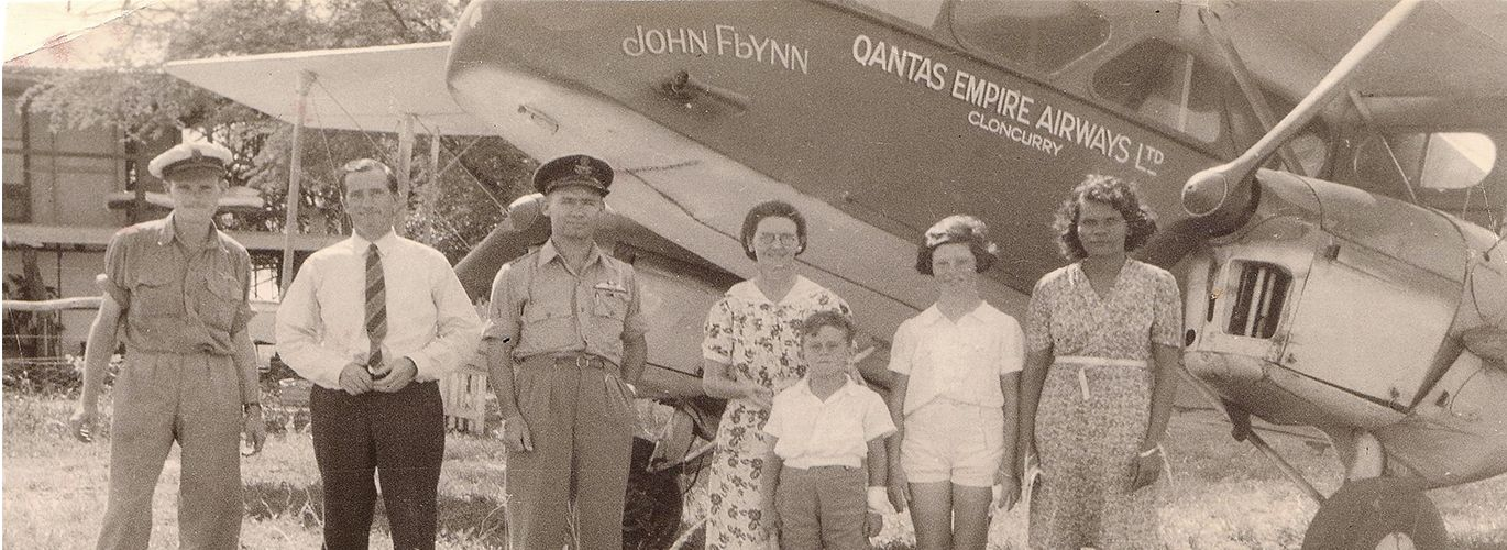 Group of people standing in front of the John Flynn Qantas Aircraft based in Cloncurry
