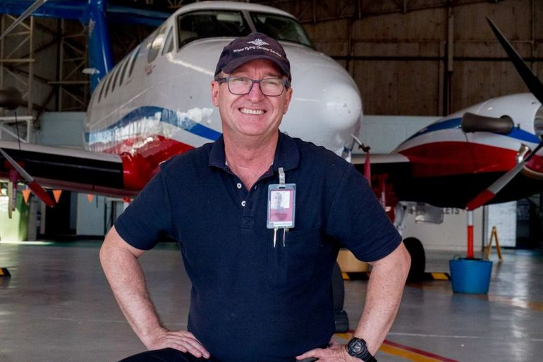 David Keavy and his plane in the RFDS hangar
