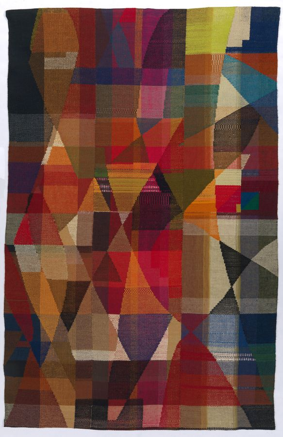 brightly coloured textile wall hanging with geometric shapes