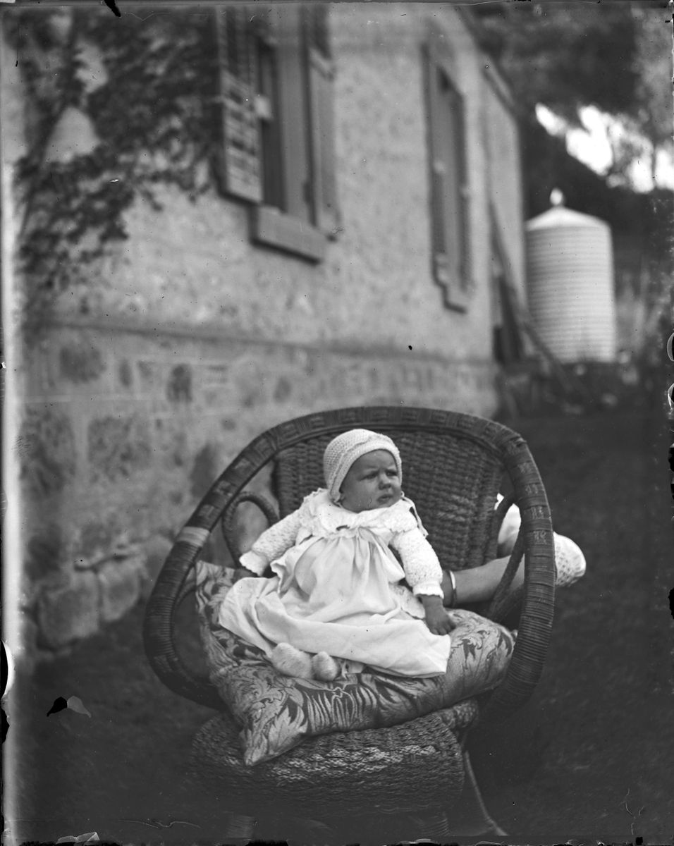 Portrait of baby upon cushion in wicker chair - AGSA ...