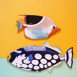 Two brightly coloured hand-painted tropical fish against an orange and aqua background.