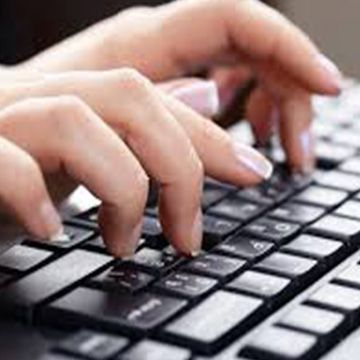 Hands typing on keyboard