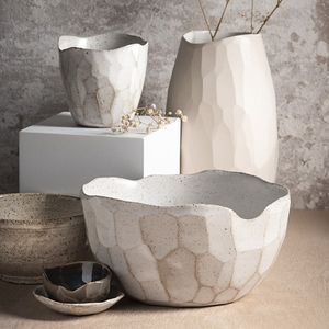 A selection of faceted ceramic vessels by Ruth Byrne.