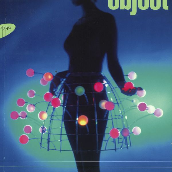 Magazine cover with a female figure wearing skirt made from light bulbs