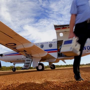 Dr leaving an RFDS plane to see a patient