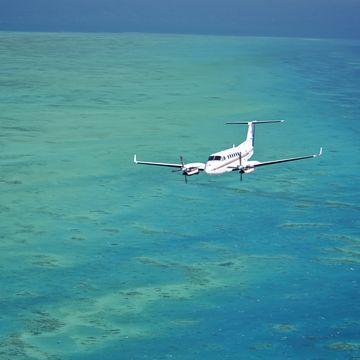 B350 Aircraft over bllue sea