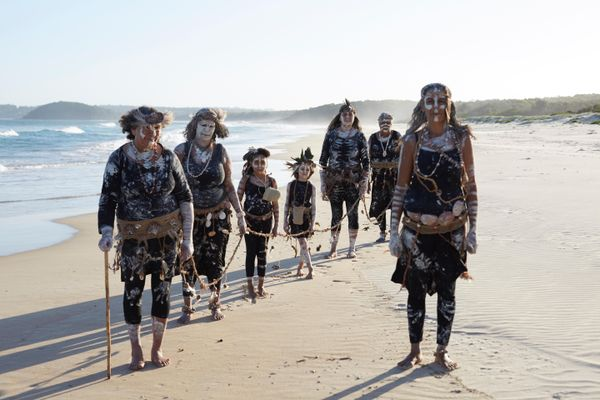 The Djaadjawan Dancers prepare for ceremony during Ngawiya Maan (we take to give) by Amanda Jane Reynolds, left to right: Aunty Vivian Mason, Aunty Leanne Mason, Arwyn Landini, Annabella Landini, Wendy Mason, Aunty Vicki Trindall and Sharon Mason; Courtesy Stella Stories and Australian Museum 2018, photo: Justine Kerrigan.