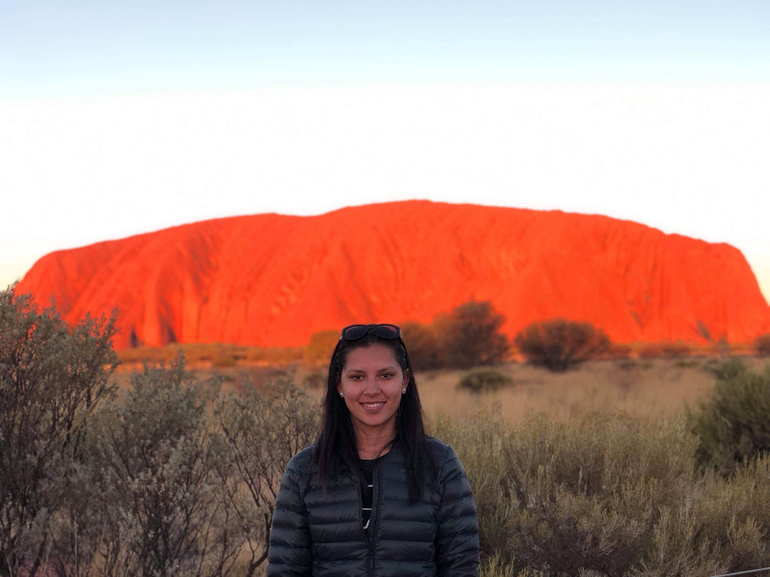 Student in front of Uluru