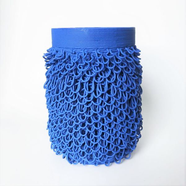 Blue ceramic vase with loopy texture on surface