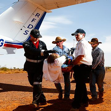 Loading a patient onto RFDS plane