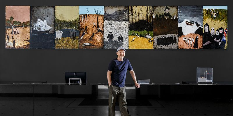2019 Ramsay Art Prize Judge, Richard Lewer standing in front of his installation 'The History of Australia'