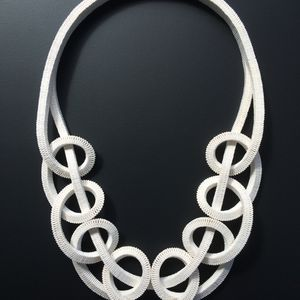 White necklace made from paper