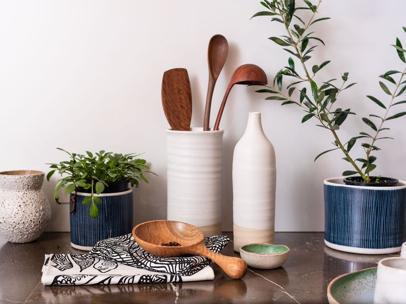 Photo of assorted crafted objects on kitchen bench