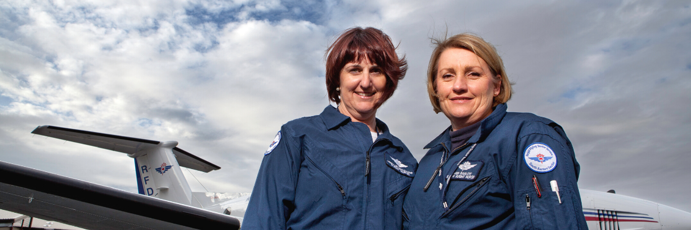 Two Royal Flying Doctor Service flight nurses standing in front of an RFDS Aircraft