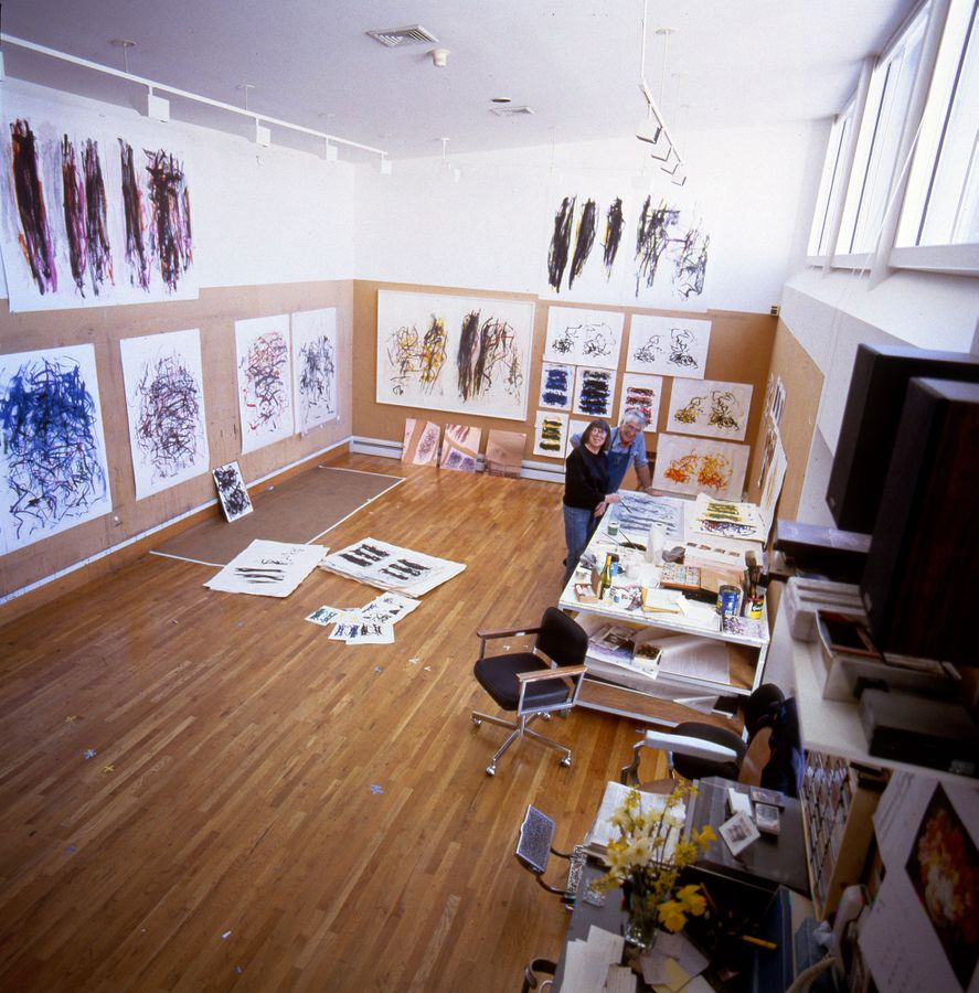 Photo of Joan Mitchell and Kenneth Tyler in studio with artwork on walls