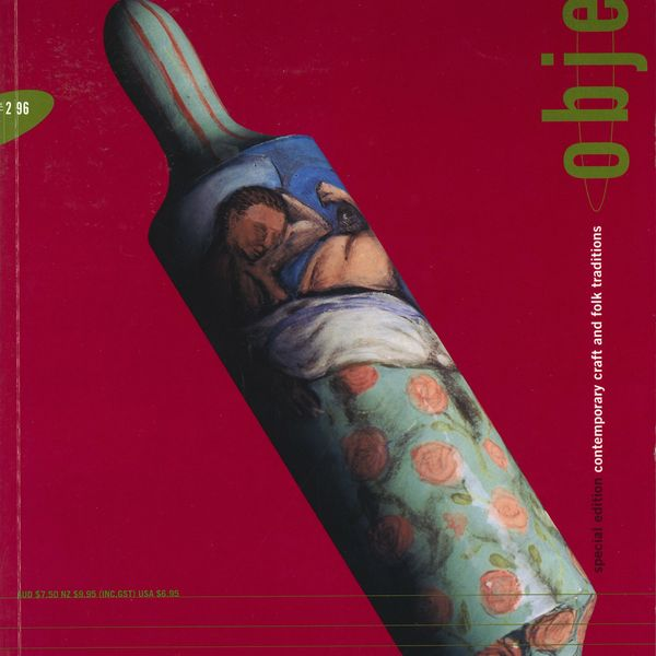 A magazine cover featuring a hand painted rolling pin in front of a red background