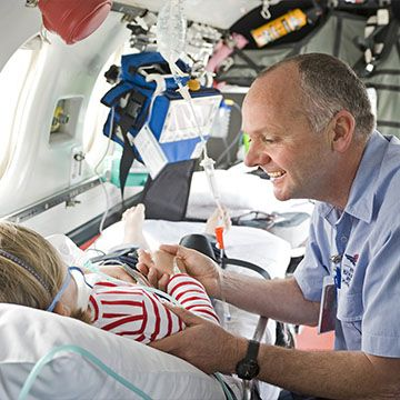 RFDS Dr checking a child is ready to fly on an rfds aeromedical flight