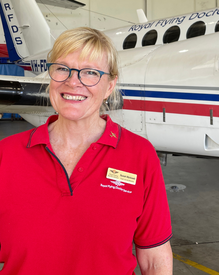 Susan Markwell with an RFDS Aircraft