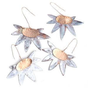 handmade brass christmas decorations in the shape of flannel flowers