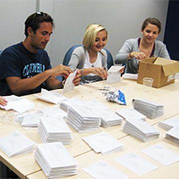 volunteers stuffing envelopes