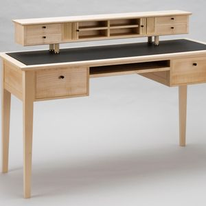 photo of a handmade wooden desk with cabinetry