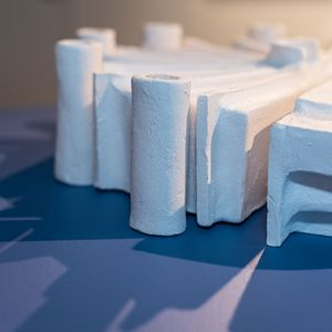 Ceramic sculpture of the Sydney Convention Centre, throwing shadows