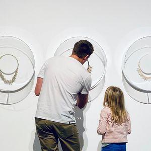 Man and girl looking closing at jewellery display
