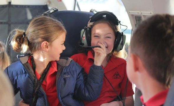 Lucy O'Connor and Bridget Marshall, Avoca Primary School enjoying the simulator experience