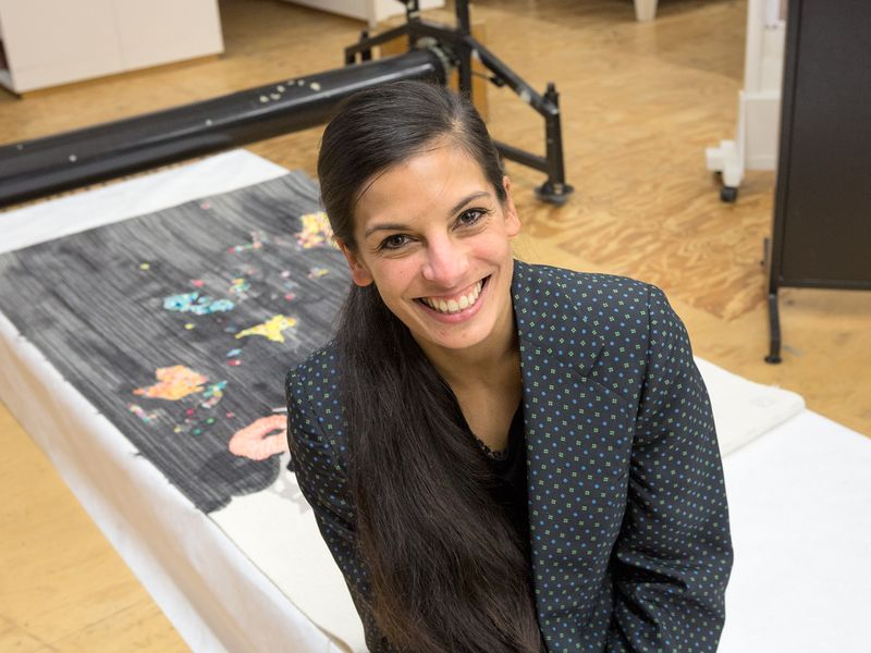 Artist Sangeeta Sandrasegar with the work she designed, Everything has two witnesses, one on earth and one in the sky (2014)