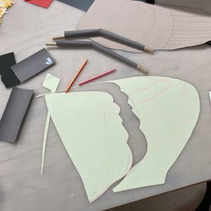 work table with paper templates, pencils and scissors