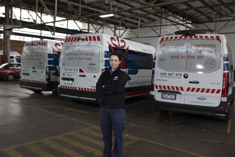 RFDS Victoria staff stands in front of patient transfer vehicles