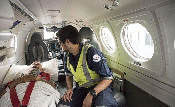 patient in stretcher in aircraft
