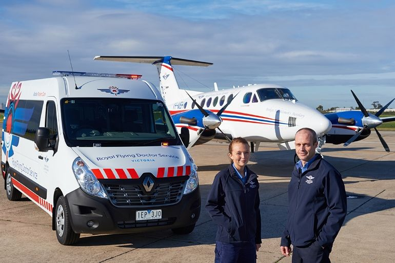 Image of plane, vehicle and two RFDS staff members