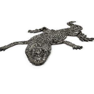 Brass mesh crocodile with onyx eyes