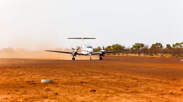 RFDS (Queensland Section) aircraft landing on dirt runway