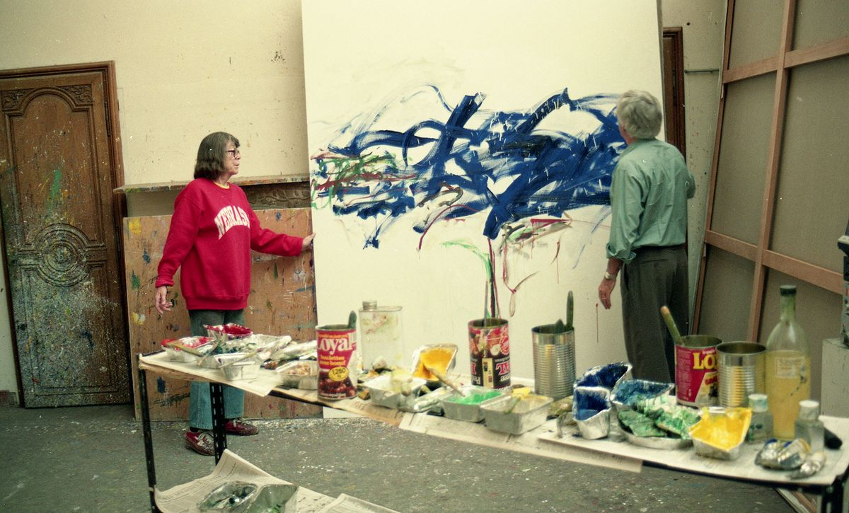 Photo of artist Joan Mitchell and Ken Tyler in studio with artwork