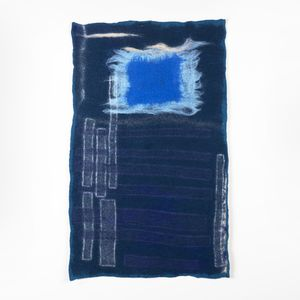 indigo blue dyed fabric with embroidered embellishments