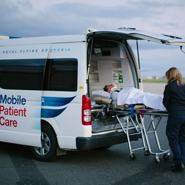 Loading a patient into an RFDS road transport vehichle