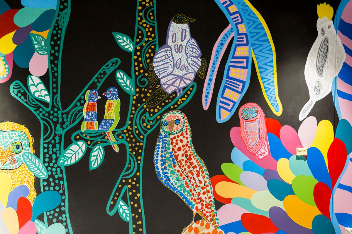 A detail of the wall painting, 'Bird Life Jungle Disco' by Studio A artists