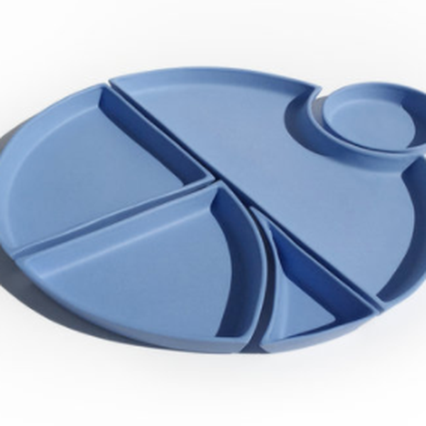 Five blue ceramic dishes that fit together to create one round bento set.