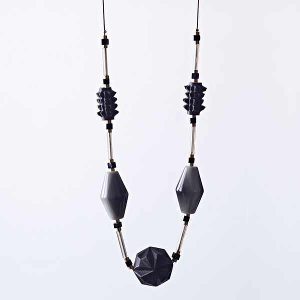 Necklace with chunky black and grey beads and fine chain.