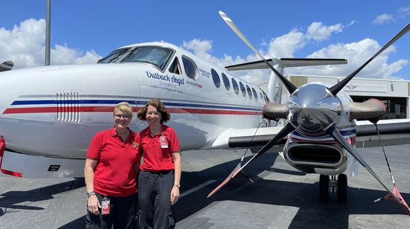 Susan Markwell and Maree Cummins with an RFDS aircraft