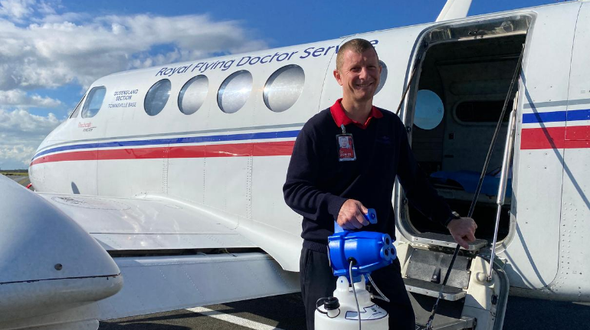 Clayton Judd in front of RFDS Aircraft