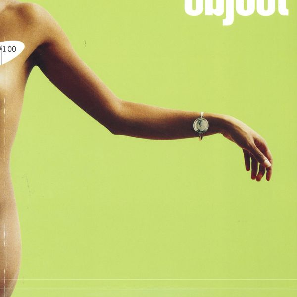 Magazine cover with nude female figure against a green backdrop, the model wears a bracelet
