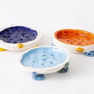 Three colourful ceramic dishes