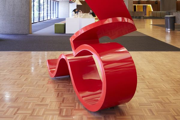 A photo of a large red sculpture in an interior space