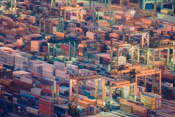Photo of a shipping port with stacked containers